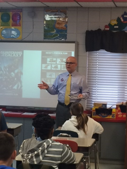 Mr. Kimbell sharing economics lesson with 6th grade