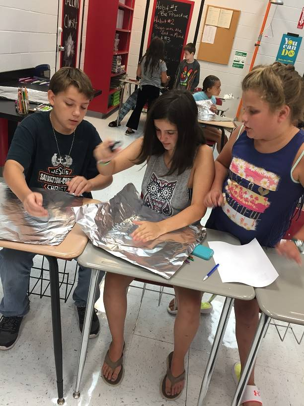 A small group works on an activity.