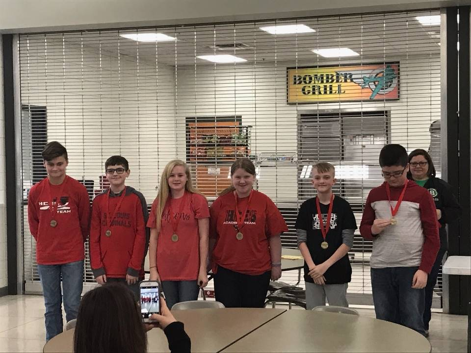 HCMS students display their medals at District Governor's Cup competition.