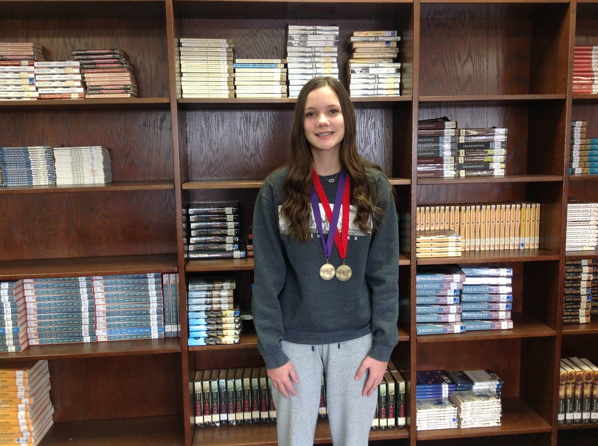 HCMS student displays her medal from District Governor's Cup competition.