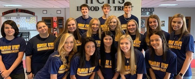 Members of the senior class pose for a photo wearing Murray State University tee shirts.